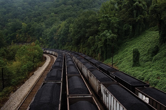 photo of Norfolk Southern railroad trains of uncovered hopper cars filled with coal (photo by Stacy Kravitz from Mother Jones Magazine)